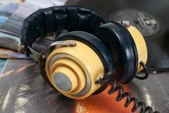 Vintage headphone and old vinyls Stock Photo
