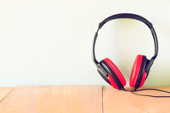 Vintage headphones over wooden table Royalty Free Stock Images