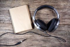 Vintage Headphones and paper note on wood Stock Photo