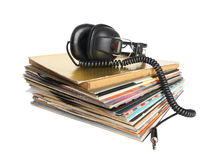 Vintage headphones on the stack of vinyl records Stock Photography