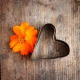 Vintage heart with flower. On wooden background Royalty Free Stock Photography