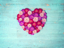 Vintage heart from flowers   on wooden table Stock Photography