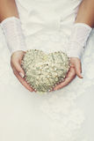 Vintage heart in the hands of the bride Royalty Free Stock Photos