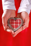 Vintage heart in hands Royalty Free Stock Photos