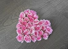 Vintage heart made of pink rose stock photo