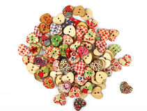 Vintage heart shaped sewing buttons over white Stock Photo