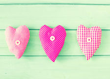 Vintage hearts over wood Royalty Free Stock Photography