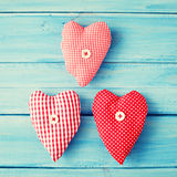 Vintage hearts over wood Stock Photo