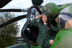 Vintage helicopter and sexy salute Stock Image