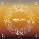 Vintage hello autumn text leaves and bikes backgro stock illustration
