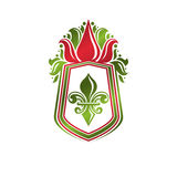 Vintage heraldic emblem created with lily flower royal symbol. E Royalty Free Stock Photography