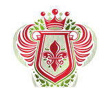 Vintage heraldic emblem created with monarch crown and lily flow Stock Photos