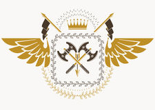 Vintage heraldry design template with bird wings, vector emblem. Created with royal crown and hatchets Stock Photo