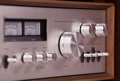 Vintage hi-fi Stereo Amplifier in wooden cabinet. Perspective, closeup royalty free stock photography