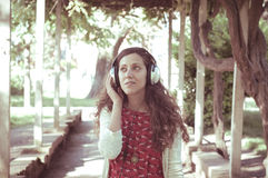 Vintage hipster eastern woman with headphones Stock Photography