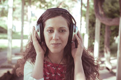 Vintage hipster eastern woman with headphones Stock Image