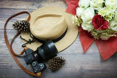 Vintage hipster hat and camera on wooden background still life royalty free stock image