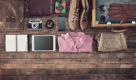 Vintage hipster traveler clothing and accessories. Hipster vintage accessories and clothing on a wooden table before packing, travel and vacations concept, top Royalty Free Stock Images