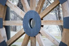 Steam boat wagon wheel close up. Vintage and historic round wood steamboat wheel  in bismarck North dakota next to the missouri river in the park in the cool Stock Photography