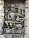 Vintage historic stone art of Indian Gods in an ancient Hindu Indian temple Royalty Free Stock Photography