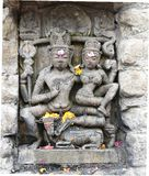 Vintage historic stone art of Indian Gods in an ancient Hindu Indian temple Stock Photography