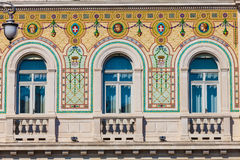 Vintage historical building facade with antique decorations windows Royalty Free Stock Photos