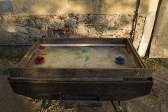 Vintage Hockey Table. An old Hockey Table near a Wall Royalty Free Stock Image