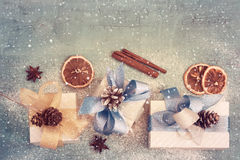 Vintage Holiday background with New Year`s gifts, tinted. Top view with copy space Stock Photos
