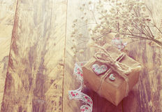 Vintage holiday background with small gift Stock Images
