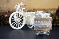 Vintage home decoration with linen cloth glass jar. Glass jar with linen cloth and vintage background royalty free stock photo