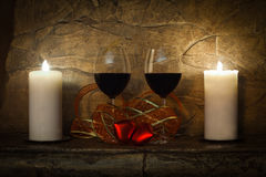 Vintage home design. Two glasses of wine, candle and teddy red heart. Valentines day interior Royalty Free Stock Photography