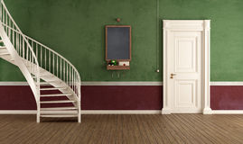 Vintage home entrance with circular staircase Stock Photo