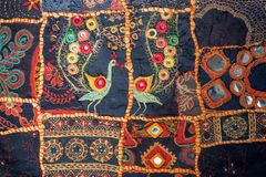 Vintage homemade patchwork background. Colorful ethnic handmade details and patterns on texture of old blanket. Patch work design art surface Stock Photo