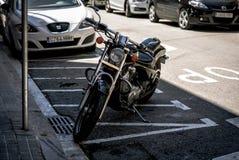 Vintage Honda bike is staying on street of of Barcelona town, Spain Stock Image