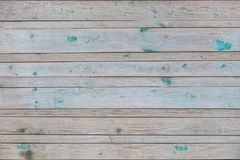 Vintage horizontal gray colour wooden boards with remains paint as background Stock Images