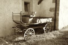 Vintage Horse Carriage Outside Old house royalty free stock photo