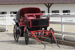 Vintage horse drawn carriage in stable parking Royalty Free Stock Photography