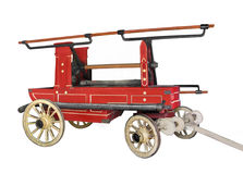 Vintage horse drawn fire wagon isolated. Stock Photo