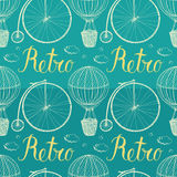 Vintage hot air balloon and bicycle. Blue backgrou Royalty Free Stock Photos