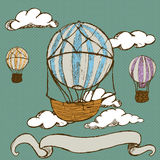 Vintage hot air balloons. Hand drawn doodle illustration of vintage hot air balloons with banner Royalty Free Stock Photography