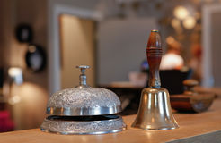 Vintage hotel bell. Close up of vintage hotel bell with blurred background Royalty Free Stock Images