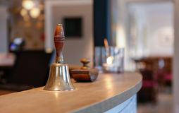 Vintage hotel bell. Close up of vintage hotel bell with blurred background Stock Image