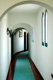 Vintage hotel corridor. Classic hotel corridor with archs and arched windows. Black and White available Royalty Free Stock Photography