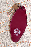 Vintage hotel key and map Royalty Free Stock Image