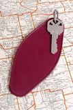 Vintage hotel key and map Stock Image
