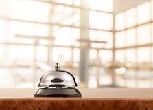 Vintage hotel reception service desk bell. Bell service desk reception hotel table background Royalty Free Stock Image