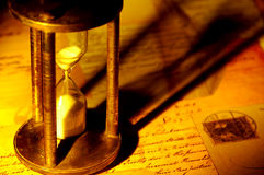 Vintage Hourglass. Photo of a Hourglass and Old Letters With Creative Lighting Stock Photography