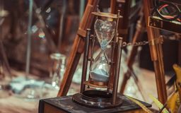 Vintage Hourglass Compass On Books stock photos