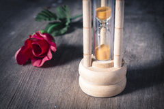 Vintage hourglass with rose. Stock Images
