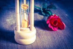 Vintage hourglass with rose. Stock Image